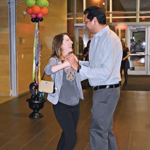 A couple dances in the lobby near the library's entrance during After Hours, the Foundation's annual fundraising event.